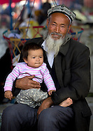 Old Uyghur man and baby, Serik Buya market, Yarkand, Xinjiang Uyghur autonomous region, China.