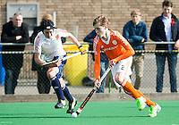 ROTTERDAM -    Floris de Bie (r)  (Neth)  with Callum Bell  (Eng).     Practice Match  Hockey : Netherlands Boys U16  v England U16 . COPYRIGHT KOEN SUYK