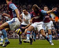 Photo: Ed Godden.<br /> Tottenham Hotspur v Aston Villa. The Barclays Premiership. 26/12/2006. Spurs' Steed Malbranque (C), is tackled by Olof Mellberg (R).