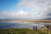 BORTH, WALES, UK 16TH MARCH 2020 - Twp tourists walking the Ceredigion coastal footpath with view of Borth coastal village, County of Ceredigion, Mid Wales, UK.