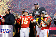 Kansas City Chiefs' Patrick Mahomes, left, Travis Kelce, center, and Tyrann Mathieu, right, celebrate after winning a NFL, AFC Championship football game against the Tennessee Titans, Sunday, Jan. 19, 2020, in Kansas City, MO. The Chiefs won 35-24 to advance to Super Bowl 54. (AP Photo/Colin E. Braley) Colin Eric Braley Photography
