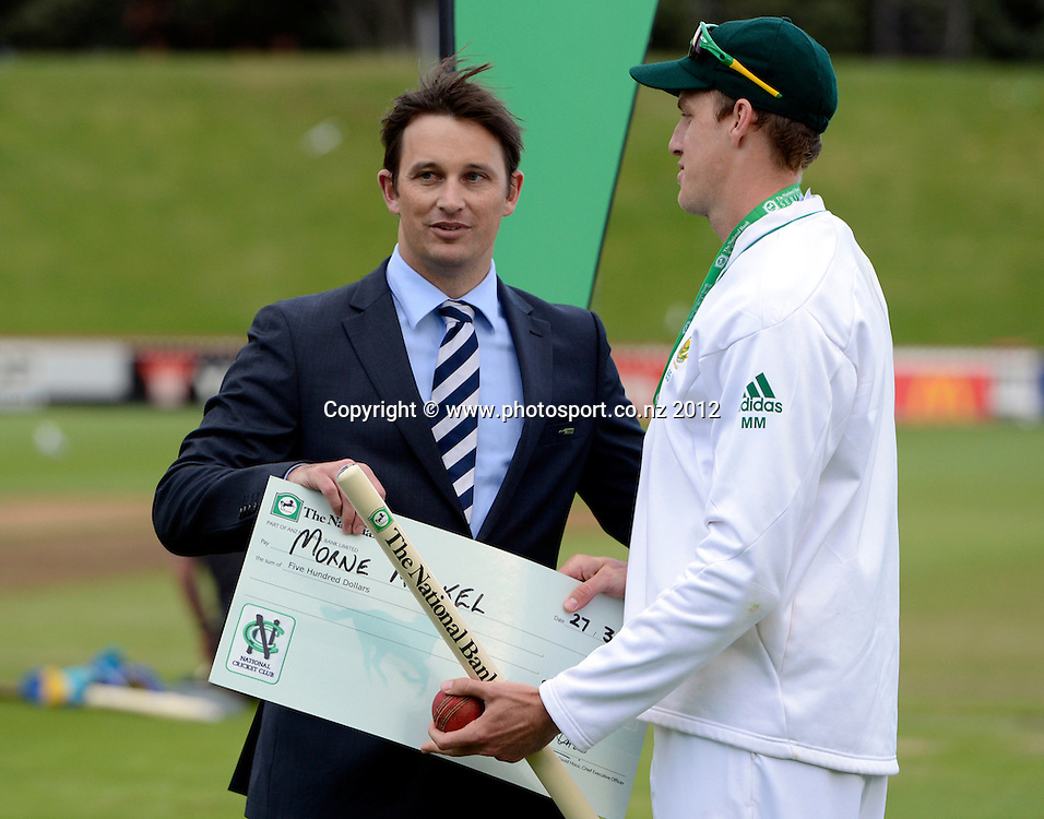 Shane Bond presents South Africa's Morne Morkel with a mon of the match cheque. Third Test, Day 5. New Zealand Black Caps versus South Africa Proteas, Basin Reserve, Wellington, New Zealand. Tuesday 27 March 2012. Photo: Andrew Cornaga/Photosport.co.nz