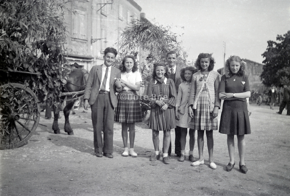 group of girls and boys posing during a village feast France early 1960s