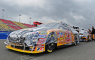 Feb. 21, 2010; Fontana, CA, USA; The car of NASCAR Sprint Cup Series driver Jeff Burton sits on pit road as it rains prior to the Auto Club 500 at Auto Club Speedway. Mandatory Credit: Jennifer Stewart-US PRESSWIRE