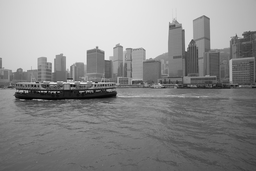 Asia, Peoples Republic of China, Hong Kong, Star Ferry sailing across Hong Kong Harbour past Central district's city skyline.