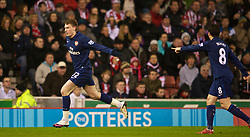 STOKE-ON-TRENT, ENGLAND - Saturday, February 27, 2010: Arsenal's Nicklas Bendtner celebrates scoring the equalising goal against Stoke City during the FA Premier League match at the Britannia Stadium. (Photo by David Rawcliffe/Propaganda)