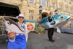 © Licensed to London News Pictures. 12/05/2012. Bristol, UK. Picture of Zoe Strickland in fish costume and Suzie Winters as a fishmonger in Corn Street, Bristol, part of the Greenpeace south west launch of Be A Fisherman's Friend campaign on supporting sustainable fishermen, getting the public's support.  12 May 2012..Photo credit : Simon Chapman/LNP