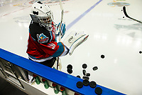 KELOWNA, CANADA - DECEMBER 7:  Roman Basran #30 of the Kelowna Rockets clears the pucks from the boards for warm up against the Victoria Royals on December 7, 2018 at Prospera Place in Kelowna, British Columbia, Canada.  (Photo by Marissa Baecker/Shoot the Breeze)