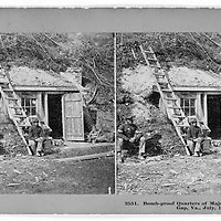 African-American Union soldiers sit outside the bomb-proof quarters of Major Thomas J. Strong at Dutch Gap, VA in July 1861.