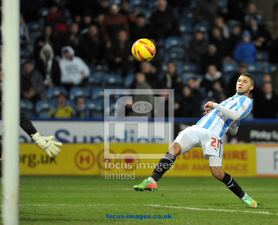 Picture by Graham Crowther/Focus Images Ltd +44 7763 140036<br /> 11/01/2014<br /> Nahki Wells of Huddersfield Town scores oin his debut against Millwall during the Sky Bet Championship match at the John Smiths Stadium, Huddersfield.