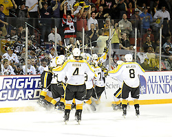 TheBrandon Wheat Kings celebrate the overtime winning goal in the semi-final game of the 2010 MasterCard Memorial Cup in Brandon, MB on Friday May 21. Photo by Aaron Bell/CHL Images