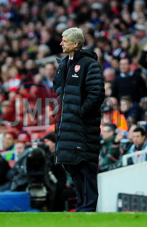 Arsenal Manger, Arsene Wenger cuts dejected figure - Photo mandatory by-line: Dougie Allward/JMP - Tel: Mobile: 07966 386802 16/02/2013 - SPORT - FOOTBALL - Emirates Stadium - London -  Arsenal V Blackburn Rovers - FA Cup - Fifth Round