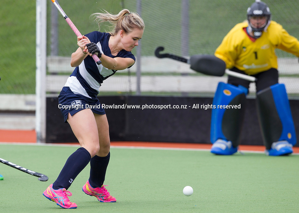 Auckland`s Charlotte Harrison hits a ball towards Northland`s goalkeeper Nicky Howes in the Auckland v Northern Women`s Final match, Ford National Hockey League, North Harbour Hockey Stadium, Auckland, New Zealand,Sunday, September 14, 2014. Photo: David Rowland/Photosport