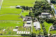 Nederland, Utrecht, Gemeente De Ronde Venen, 27-09-2015; Baambrugge, Boerderij  Lindenhoff (met tunnels).<br /> luchtfoto (toeslag op standard tarieven);<br /> aerial photo (additional fee required);<br /> copyright foto/photo Siebe Swart
