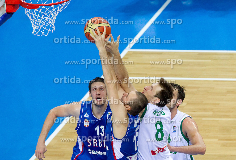 Kosta Perovic of Serbia, Milan Macvan of Serbia vs Matjaz Smodis of Slovenia during basketball game between National basketball teams of Slovenia and Serbia in 7th place game of FIBA Europe Eurobasket Lithuania 2011, on September 17, 2011, in Arena Zalgirio, Kaunas, Lithuania. Slovenia defeated Serbia 72 - 68 and placed 7th. (Photo by Vid Ponikvar / Sportida)