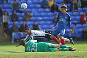 Joe Thompson tumbles under pressure from Liam Shephard during the EFL Sky Bet League 1 match between Peterborough United and Rochdale at London Road, Peterborough, England on 14 April 2018. Picture by Daniel Youngs.
