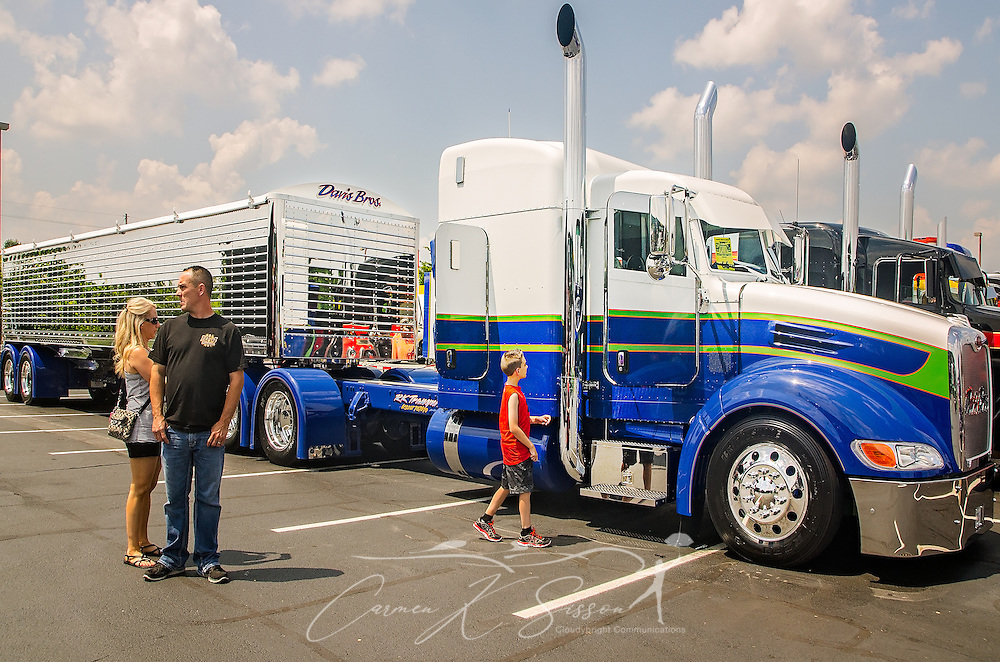 "Truck enthusiasts admire the Davis Bros.' ""Buzz Kill,"" a 2015 Peterbilt 386 with a 2016 Wilson DH501 trailer, during the 34th annual Shell Rotella SuperRigs, June 11, 2016. SuperRigs, organized by Shell Oil Company, is an annual beauty contest for working trucks. Approximately 89 trucks entered this year's competition. ""Buzz Kill"" won in the nonworking show truck category. (Photo by Carmen K. Sisson/Cloudybright)"