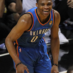 Jun 19, 2012; Miami, FL, USA; Oklahoma City Thunder point guard Russell Westbrook (0) reacts during the first quarter in game four in the 2012 NBA Finals against the Miami Heat at the American Airlines Arena. Mandatory Credit: Derick E. Hingle-US PRESSWIRE