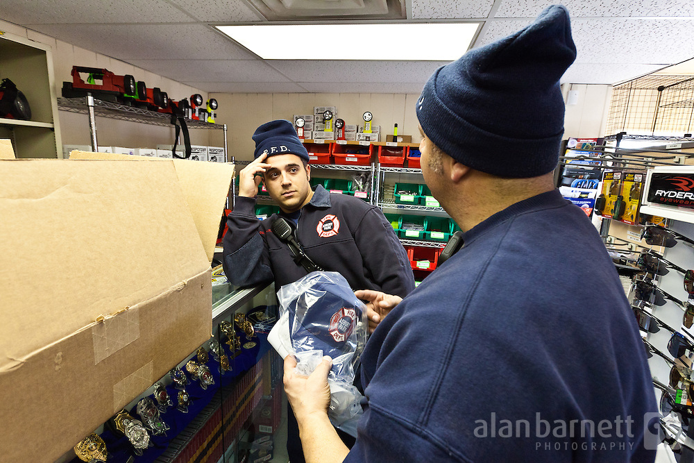 Firefighters spend their clothing allowance at a local uniform shop.