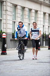 Olympic Gold Medalists, runner Sally Gunnell and cyclist Chris Boardman go head to head to find the quickest and easiest way to get around London during the London 2012 Olympic Games. The challenge come as 60 per cent of businesses encourage staff the to walk or cycle to work during games time, Thursday May 17, 2012. Photo By i-images