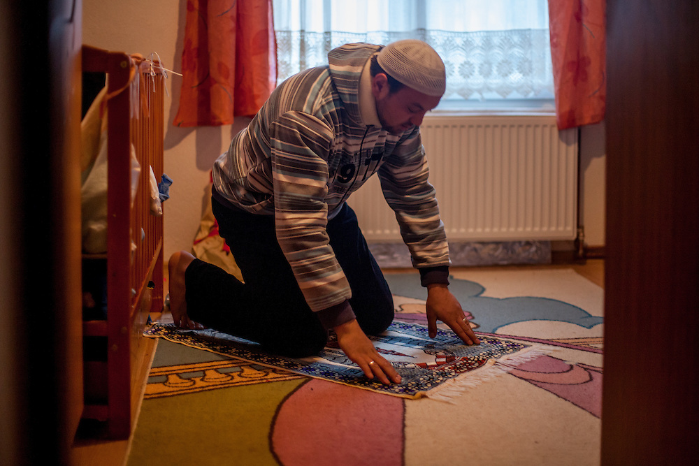 Elvis Causevic praying at home. Elvis was a Bosnian refugee child I met in 1992 at the Varazdin refugee camp in Croatia (he was 6 years old) and with the help of Radio Free Europe and an appeal for Elvis to get in touch broadcasted on Bosnian television, social networks and on the RFERL Balkan Service web page it took just 12 hours to find Elvis, who lives now in Sarajevo, his new home after the war. He is married and has two children. Elvis originally came form the city of Foča and fled the war in 1992 with his mother, sister and grandmother for 18 days through the Bosnian mountains till they reached a save place at the refugee camp Varazdin in Croatia where they stayed for 3 years before leaving for a longer period of time to Munich in Germany before they returned 1999 to Bosnia.
