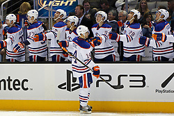 Mar 6, 2012; San Jose, CA, USA; Edmonton Oilers right wing Jordan Eberle (14) is congratulated by teammates after scoring a goal against the San Jose Sharks during the first period at HP Pavilion. Mandatory Credit: Jason O. Watson-US PRESSWIRE