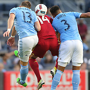 NEW YORK, NEW YORK - June 02: Yura Movsisyan #14 of Real Salt Lake is sandwich by Frederic Brillant #13 of New York City FC and Ethan White #3 of New York City FC as they go for the ball  during the NYCFC Vs Real Salt Lake regular season MLS game at Yankee Stadium on June 02, 2016 in New York City. (Photo by Tim Clayton/Corbis via Getty Images)