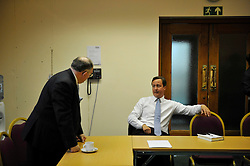Leader of the Conservative Party David Cameron surrounded by his press aides signs a copy of Cameron on Cameron for  Councillor John Walsh (left) in the green room at the Albert Hall, Bolton, after giving a speech on the NHS, on the last day of  his 3 day  tour of Yorkshire and the North West England, Thursday, August 20, 2009. Photo By Andrew Parsons / i-Images.