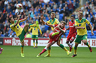 Aron Gunnarsson of Cardiff city &copy; has a shot at goal blocked by Wes Hoolahan of Norwich city (left).  Skybet football league championship match, Cardiff city v Norwich city at the Cardiff city Stadium in Cardiff, South Wales on Saturday 13th Sept 2014<br /> pic by Andrew Orchard, Andrew Orchard sports photography.
