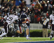 Ole Miss quarterback Bo Wallace (14) scores on a 14 yard run as Texas A&M defensive back Deshazor Everett (29) chases in Oxford, Miss. on Saturday, October 6, 2012. Texas A&M won 30-27...