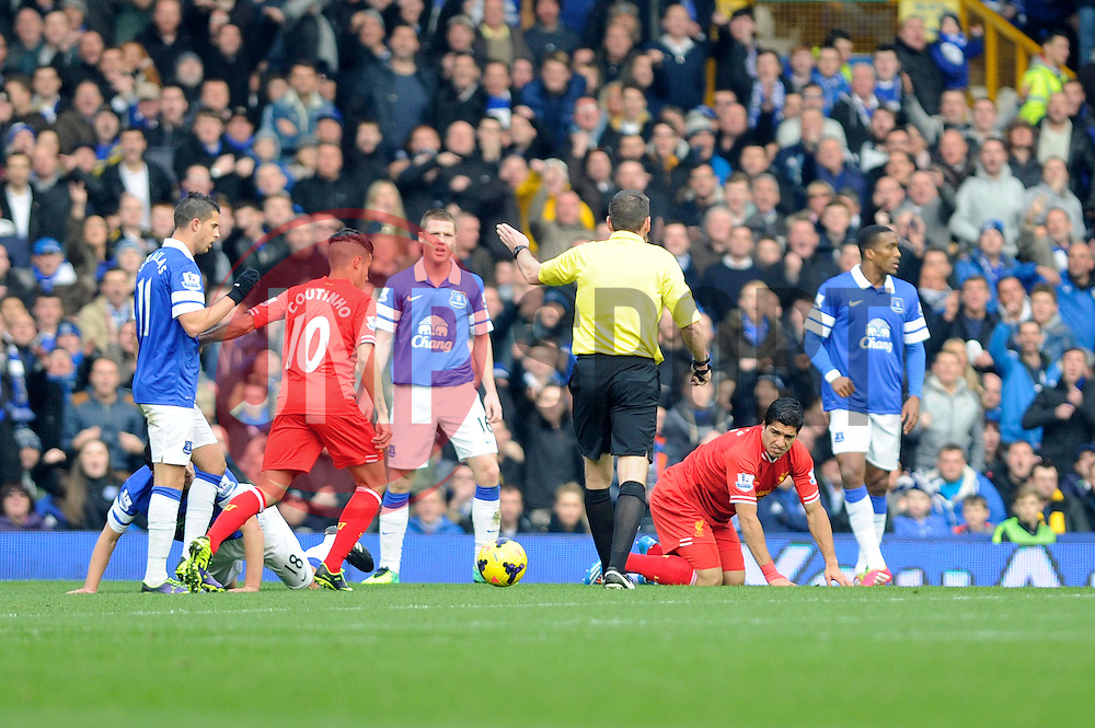 Liverpool's Luis Suarez is fouled, and is rewarded with a free kick which he later scores - Photo mandatory by-line: Dougie Allward/JMP - Tel: Mobile: 07966 386802 23/11/2013 - SPORT - Football - Liverpool - Merseyside derby - Goodison Park - Everton v Liverpool - Barclays Premier League