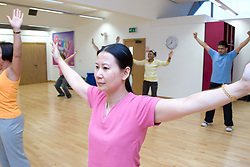 Group of adults taking part in an aerobics class at their sports leisure centre,