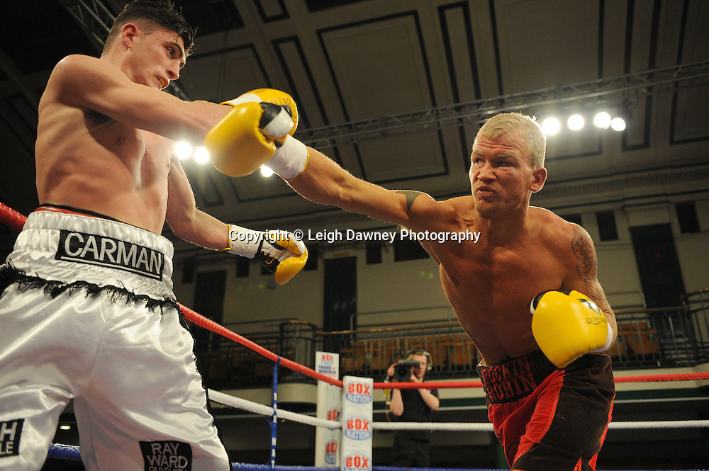 George Michael Carman (white shorts) defeats Robin Deakin in a 4x3 min rounds Light -Welterweight contest at York Hall, Bethnal Green, London on 14th December 2011. Frank Warren Promotions. Photo credit: © Leigh Dawney 2011.