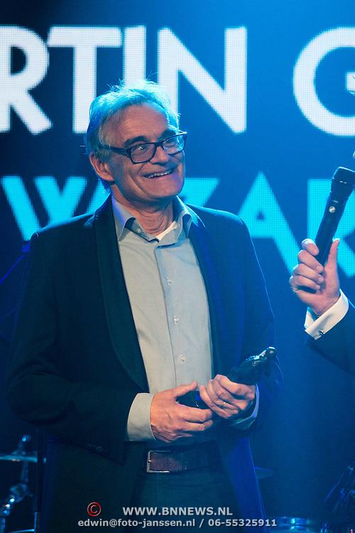 NLD/Amsterdam//20140331 - Uitreiking Edison Pop 2014, Vader van Martin Garrix neemt award in ontvangst