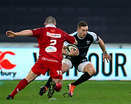 George North of Ospreys evades the tackle of Ken Owens of Scarlets<br /> <br /> Photographer Simon King/Replay Images<br /> <br /> Guinness PRO14 Round 11 - Ospreys v Scarlets - Saturday 22nd December 2018 - Liberty Stadium - Swansea<br /> <br /> World Copyright © Replay Images . All rights reserved. info@replayimages.co.uk - http://replayimages.co.uk