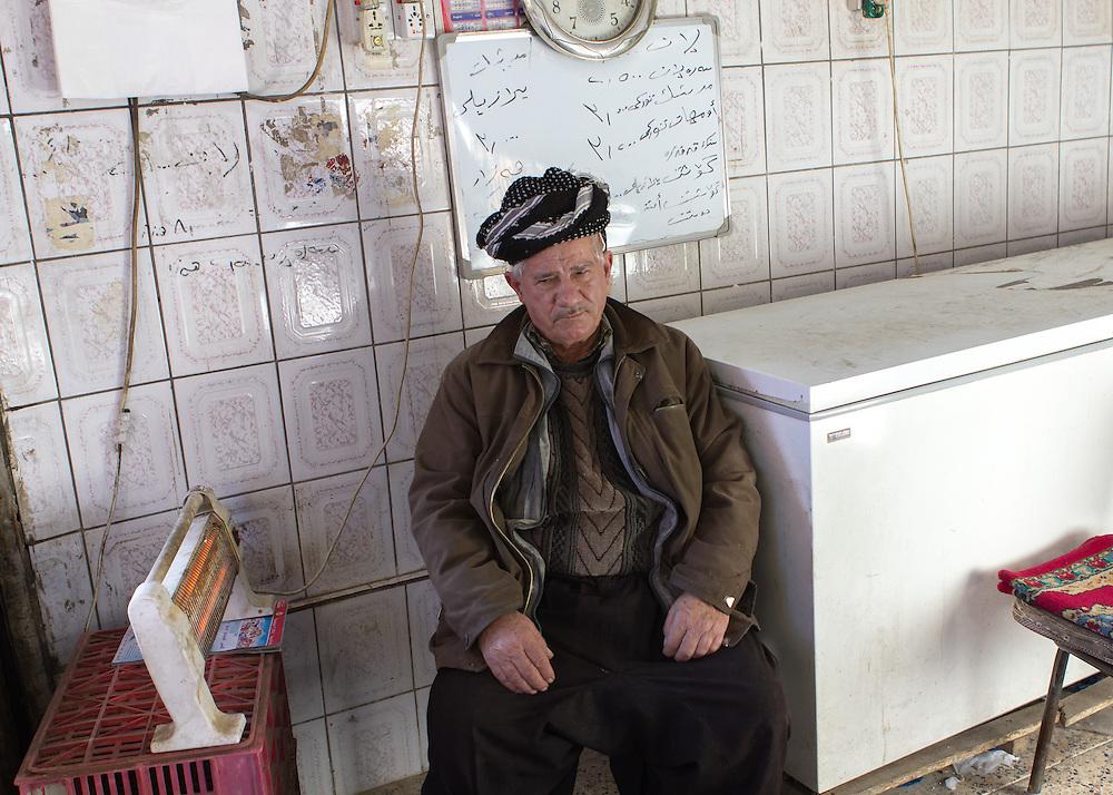 Old Kurdish salesman in a shop at the local bazar. Sulaymaniya, Iraqi Kurdistan (Iraq, 2012)
