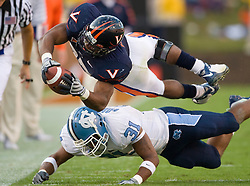 "Virginia running back Cedric Peerman (37) dives for a first down over North Carolina safety Trimane Goddard (31).  The Virginia Cavaliers defeated the #18 ranked North Carolina Tar Heels 16-13 in overtime in NCAA football at Scott Stadium on the Grounds of the University of Virginia in Charlottesville, VA on October 18, 2008.  The 113th meeting of the two teams, dubbed the ""Oldest Rivalry in the South"", saw UVA continue its streak of consecutive home victories over UNC -- the last time the Tar Heels won in Charlottesville was 1981."