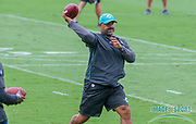 Miami Dolphins running backs coach Eric Studesville passes the ball as part of a drill during Minicamp at the Baptist Health Training Facility at Nova Southeastern University, Wednesday, June 5, 2019 in Davie, Fla. (Kim Hukari/Image of Sport)