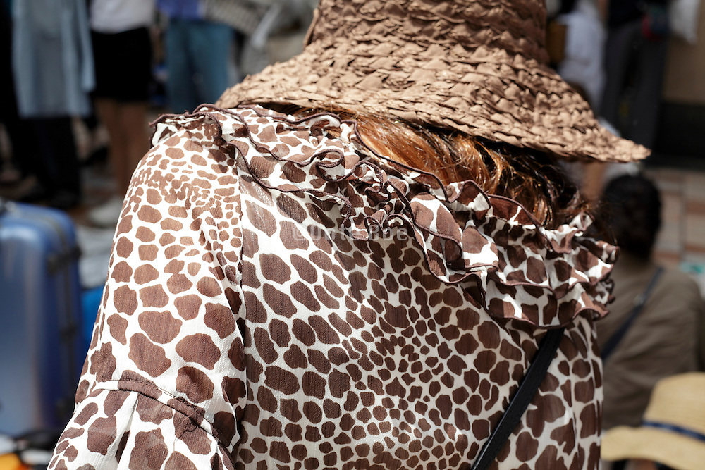 back view close up of woman wearing a animal print design dress