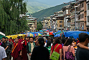 BU00023-00...BHUTAN -  Special festival street market during the annual Thimphu Tsechu (festival) draws a huge crowd of local people and young monks.