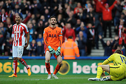 Tottenham Hotspur's Hugo Lloris cuts a dejected figure as Stoke City's Steven N'Zonzi celebrates - Photo mandatory by-line: Dougie Allward/JMP - Mobile: 07966 386802 - 09/05/2015 - SPORT - Football - Stoke - Britannia Stadium<br />  - Stoke v Tottenham Hotspur - Barclays Premier League