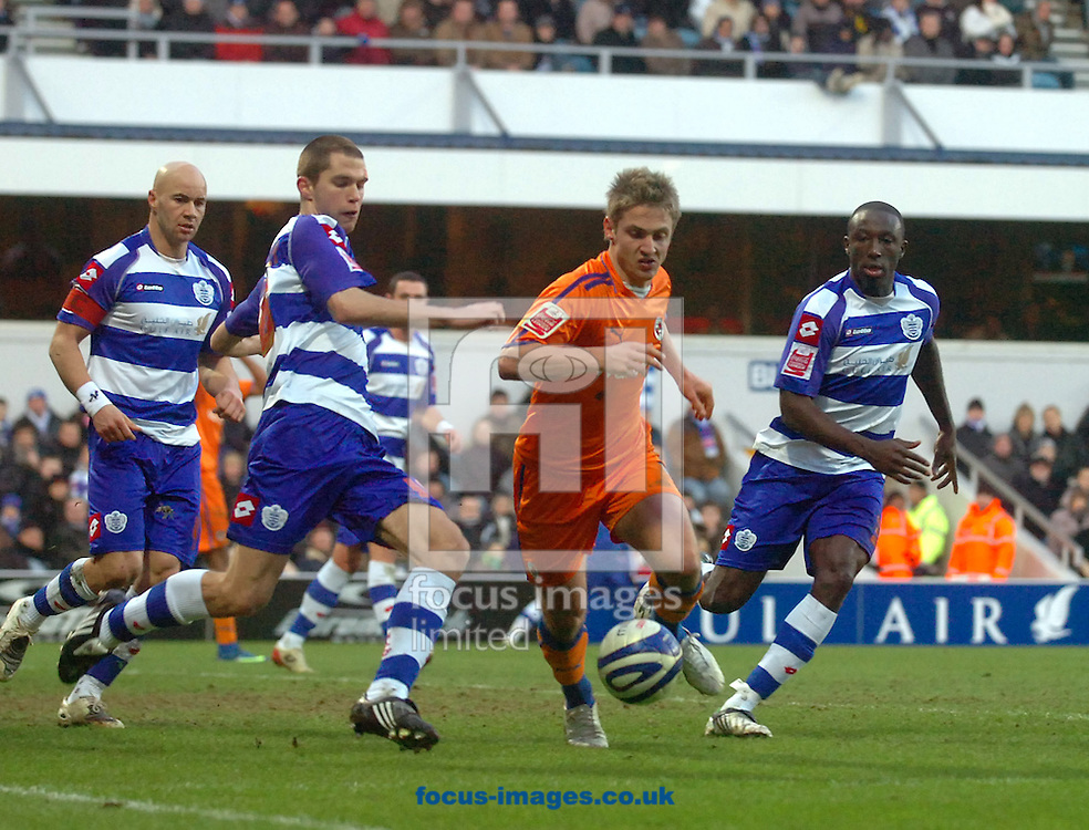 London - Saturday January 31st, 2009: Kevin Doyle of Reading tries to beat the QPR defence during the Coca Cola Championship match at Loftus Road, London. (Pic by Focus Images)