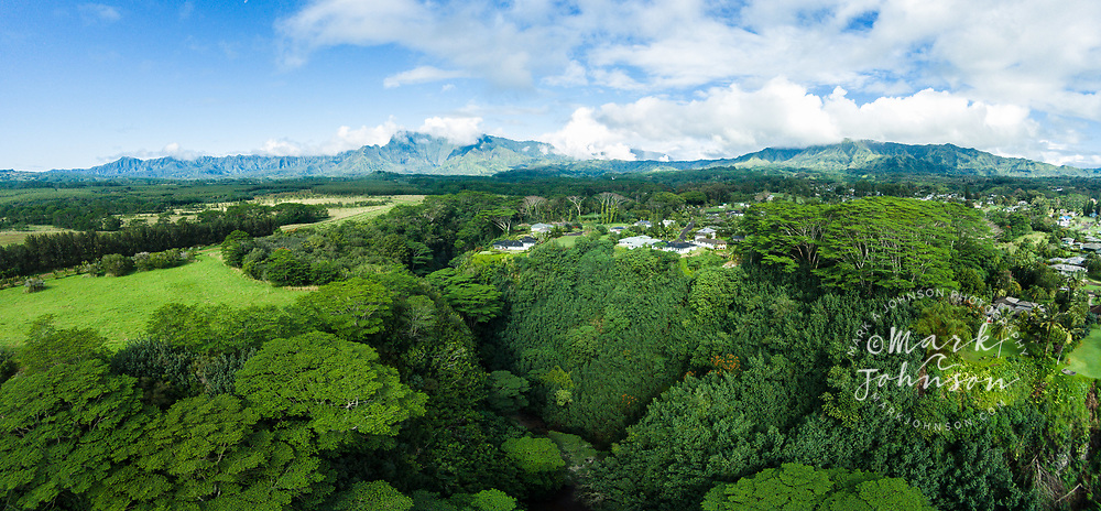 Aerial panorama photograph of homes above the North Fork of the Wailua River, Kauai, Hawaii. Mts Waialeale on the left, and Mt Makaleha on the right