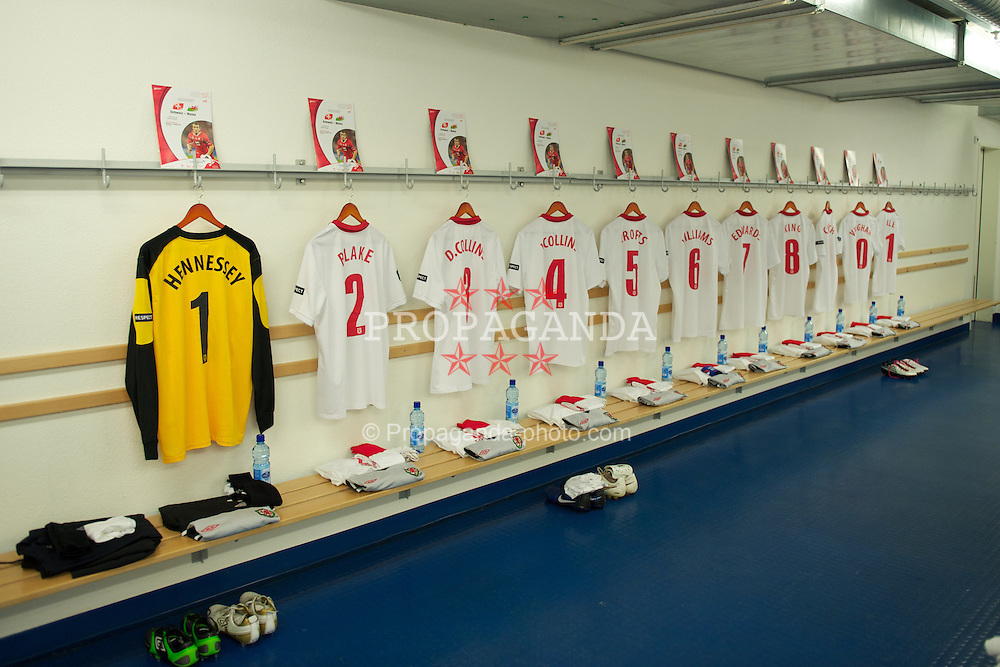 BASEL, SWITZERLAND - Tuesday, October 12, 2010: Wales players' shirts hanging in the away team dressing room before the UEFA Euro 2012 qualifying Group G match against Switzerland at St. Jakob-Park. (Pic by David Rawcliffe/Propaganda)