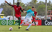 Portugal forward Herculano Nabian (9) receives a pass while Slovenia Denis Leban (16) looks to pressure the ball during a CONCACAF boys under-15 championship soccer game, Sunday, August 11, 2019, in Bradenton, Fla. Portugal defeated Slovenia in the final in 2-0. (Kim Hukari/Image of Sport)