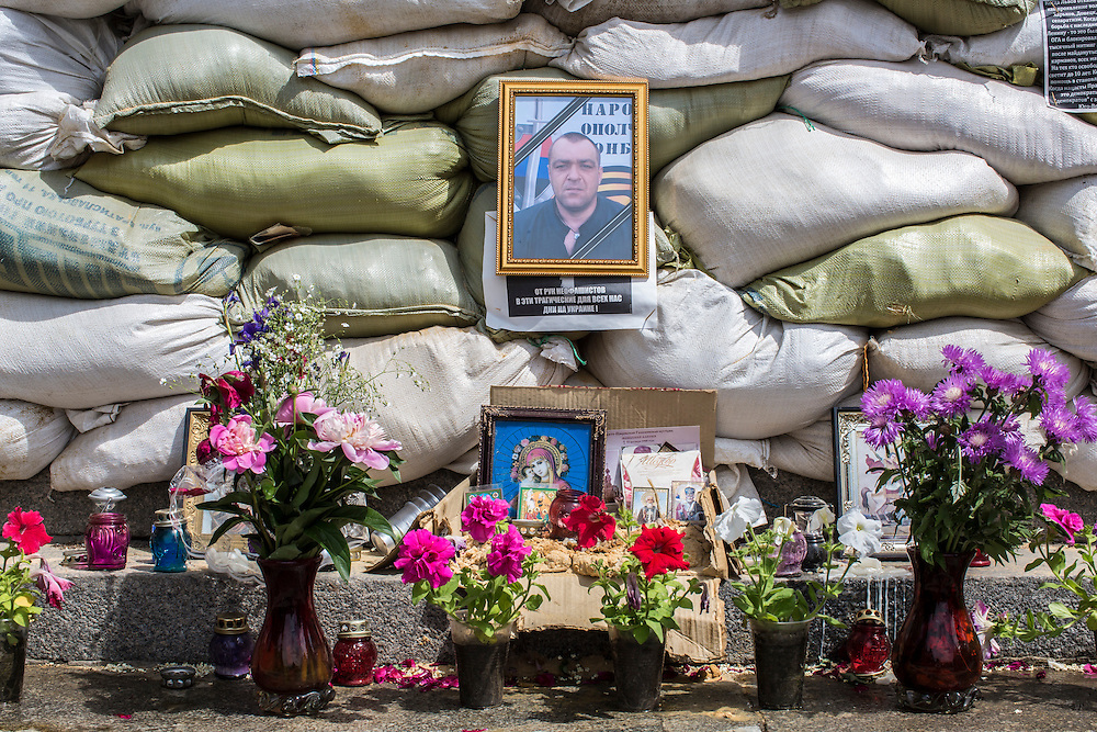 HORLIVKA, UKRAINE - MAY 24: A photo of Aleksandr Politov, a pro-Russia militia fighter who was killed when his group attacked a Ukrainian military checkpoint two days earlier in the village of Blahodatne, stands outside the occupied city administration building on May 24, 2014 in Horlivka, Ukraine. Presidential elections are scheduled for tomorrow, but pro-Russia militias have been seeking to prevent them from being administered throughout the eastern part of the country. (Photo by Brendan Hoffman/Getty Images) *** Local Caption ***