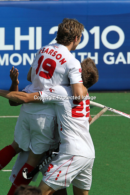 Mark Pearson of Canada celebrates the first goal for Canada during the hockey match between New Zealand and Canada during the XiX Commonwealth Games  held at the MDC Stadium in New Delhi, India on the  10 October 2010<br /> <br /> Photo by:  Ron Gaunt/photosport.co.nz
