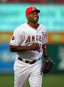 ANAHEIM, CA - JUNE 24:  Torii Hunter #48 of the Los Angeles Angels of Anaheim smiles as he heads back to the dugout during the game against the Colorado Rockies at Angel Stadium on Wednesday, June 24, 2009 in Anaheim, California.  The Angels defeated the Rockies 11-3.  ©Paul Anthony Spinelli*** Local Caption *** Torii Hunter