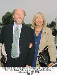 MR & MRS CHRIS WRIGHT, he is founder and chairman of the Chrysalis Group PLC., at a race meeting in Berkshire on September 20th 1996.    LSE 29