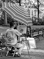 A portrait painter at work in Central Park, New York City.